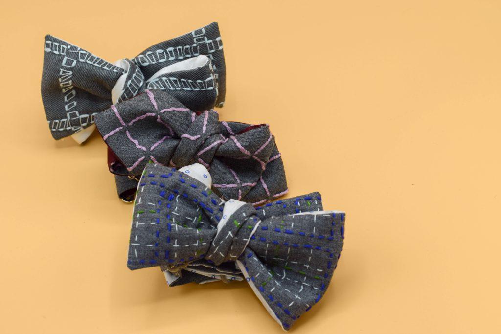 Nœuds papillons à nouer sur-mesure pièces uniques Monsieur List laine brodés main fragment filet et quadrillage coton. Fait en France.